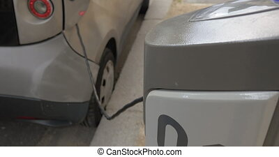Charging of electric car - Street power supply station and...