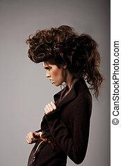 Charisma. Stylish Woman with Unusual Shaggy Hairstyle