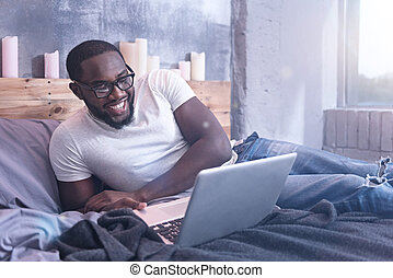 Charismatic African American man freelancing at home