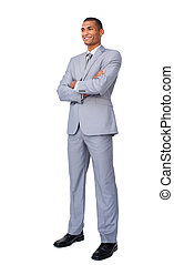 Charismatic Attractive businessman with folded arms standing