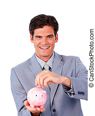 Charismatic businessman saving money in a piggy-bank