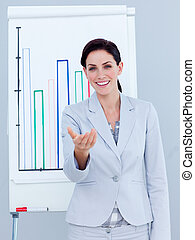 Charismatic businesswoman giving a presentation in a company