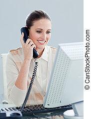Charismatic businesswoman talking on phone