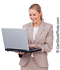 Charismatic businesswoman using a laptop isolated on a white background