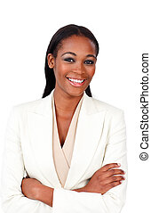 Charismatic businesswoman with folded arms smiling at the...