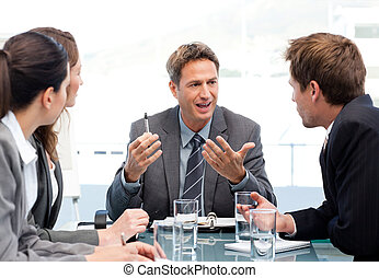 Charismatic chairman talking with his team during a meeting