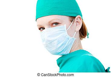 Charismatic female surgeon wearing a mask