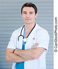 Charismatic male doctor looking at the camera