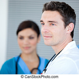 Charismatic male doctor looking at the window