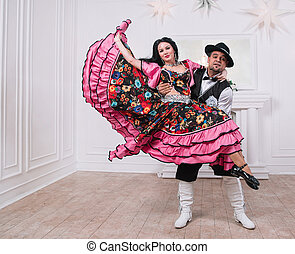 charismatic man and woman performing a fast Gypsy dance.