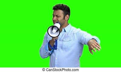 Charismatic man with megaphone on Chroma Key background....