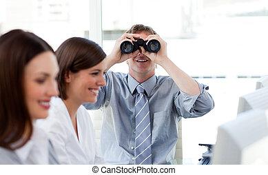 Charismatic manager looking through binoculars