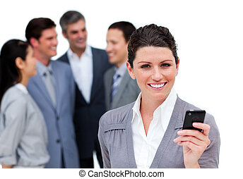 Charismatic manager on phone standig in front of his team