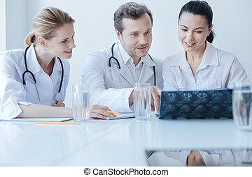 Charismatic neurosurgeon enjoying responsibilities at the...