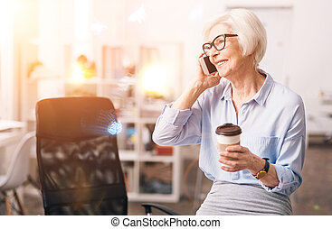 Charismatic respected businesswoman chatting on the phone
