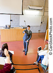 Charismatic teacher giving a lesson to university students...