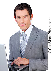 Charismatic young businessman using a laptop isolated on a...