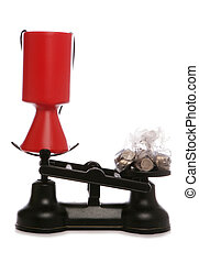 charity collection on scales with sterling money