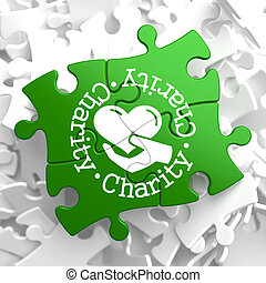Charity Concept on Green Puzzle Pieces.