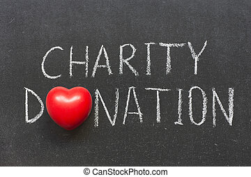 charity donation phrase handwritten on blackboard with heart symbol instead of O
