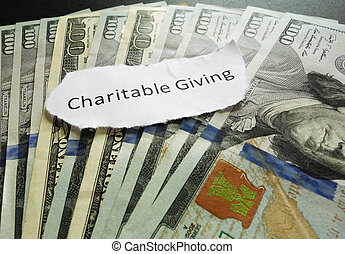 Charity giving - Charitable Giving paper message on assorted...
