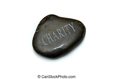 charity stone - A smooth polished stone with the word...