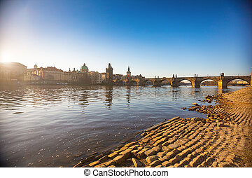 Charles Bridge and river at sunrise light in early morning