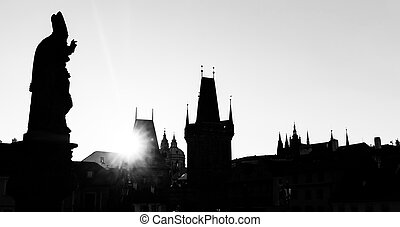 Charles Bridge at sunrise, Prague, Czech Republic. Statues and towers silhouettes