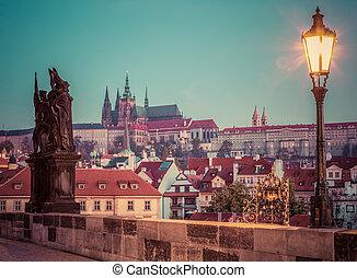 Charles Bridge at sunrise, Prague, Czech Republic. View on Prague Castle with St. Vitus Cathedral.