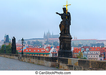 Charles Bridge in Prague (Czech Republic) at cloudy morning.