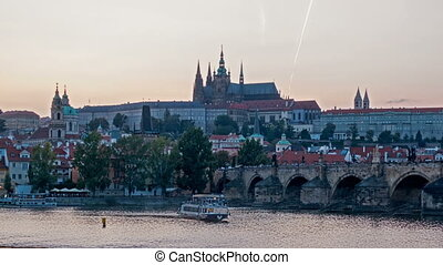 Charles Bridge over the River Vitava, Czech Republic at sunset , timelapse. day to night.