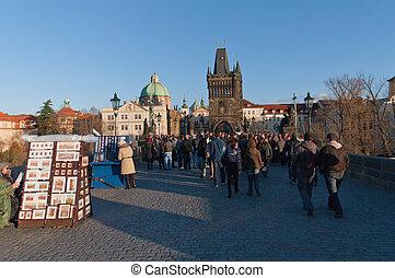 PRAGUE, CZECH REPUBLICH-NOV.12: tourist walking in charles bridge on 12th november 2011 in Prague,