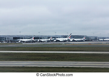 Charles de Gaulle Airport, airplanes waiting for passengers...