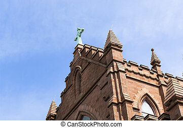 Red brick church highlighted by sunlight and blue skies in charleston sc