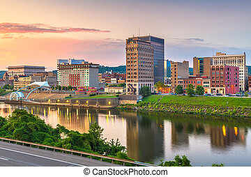 Charleston, West Virginia, USA downtown skyline on the river at dusk.