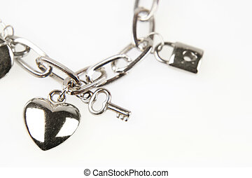 Charm bracelet - Closeup of heart and key on charm bracelet