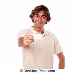 Charming adult smiling with a business card.