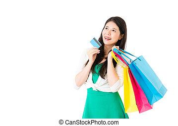charming asian woman shopping online