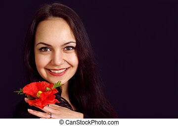 Charming attractive girl with a flower