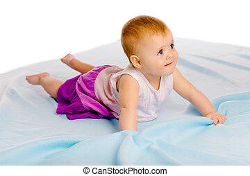 baby girl in a dress. Studio