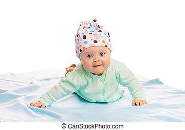 baby girl in a hat. Studio