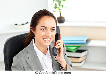 charming beautiful businesswoman talking on a phone in her...
