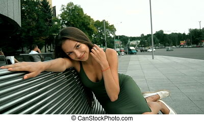 charming beautiful women sitting on a bench outdoors