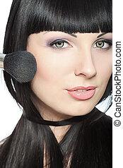 charming - Beautiful young woman posing with makeup brush. ...