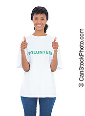 Charming black haired volunteer giving thumbs up
