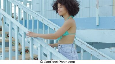 Charming black woman on beach