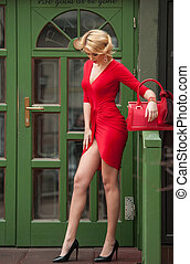 Charming blonde in red sexy dress - Charming young blonde in...