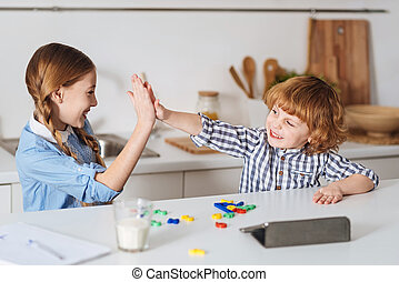 Charming brother and sister playing together