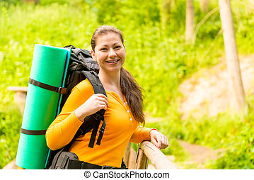 charming brunette in a hike with a backpack