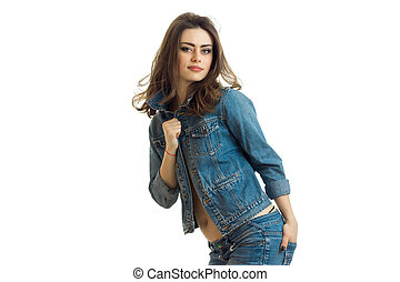 charming brunette posing on camera leaning in jeans jacket